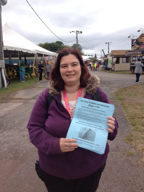 Kim Hale-Yim handing out flyers over the weekend at the Luzerne County Fair calling for Senator Lisa Baker to move a $10.10/hour or better minimum wage bill out of the Labor and Industry Committee.