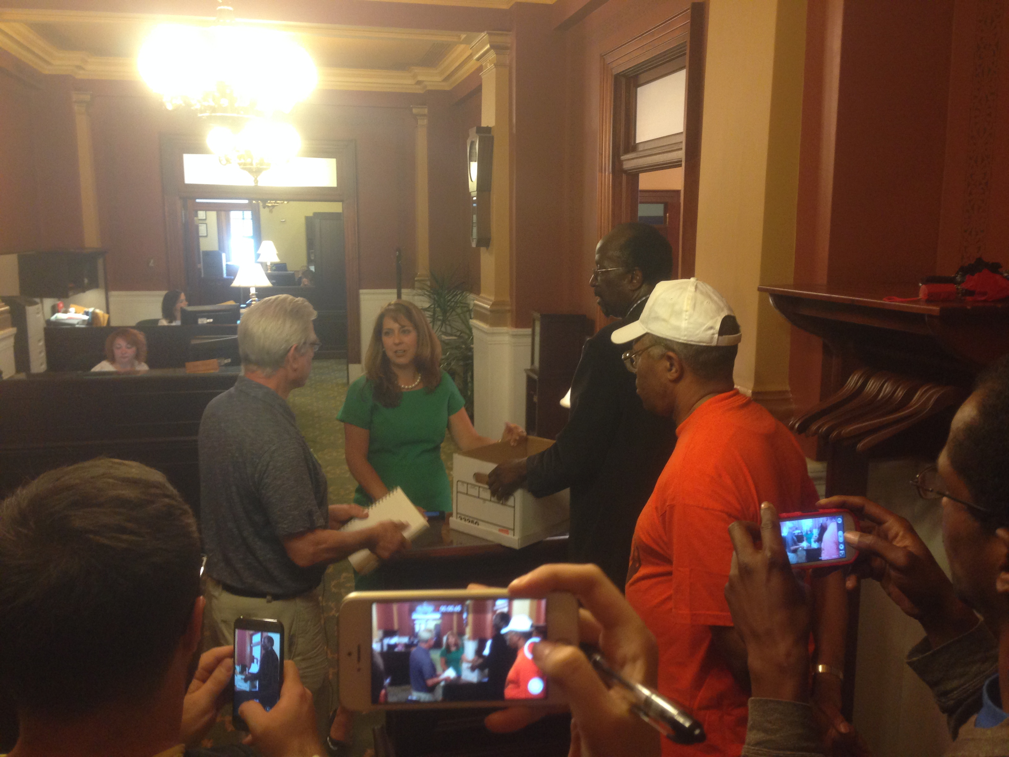 Members of the coalition deliver petitions to Senate Majority Leader Jake Corman's staff.